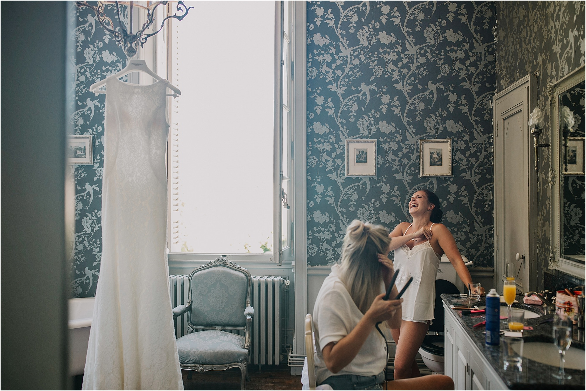 bride laughing during prep at a chateau la durantie wedding