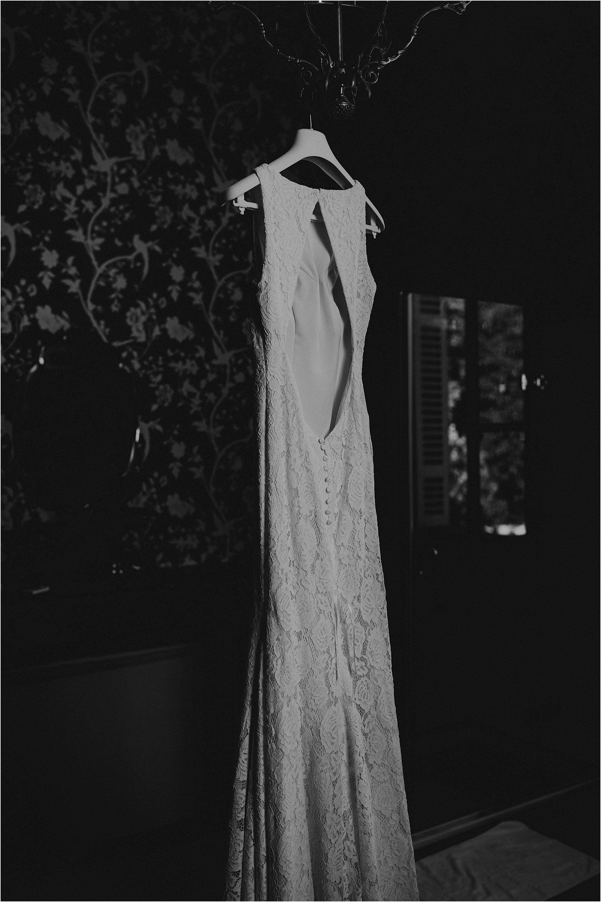 black and white image of backless pronovias dress at a chateau la durantie wedding