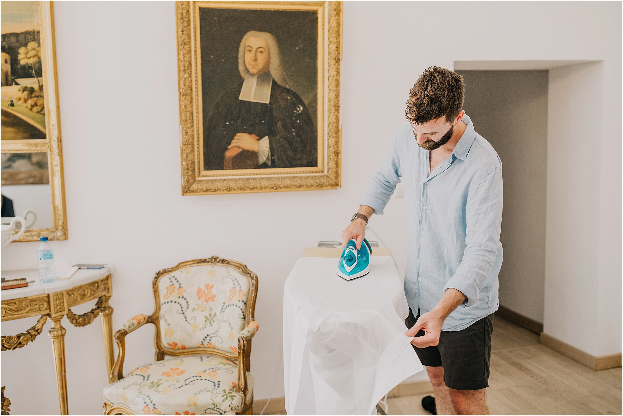 groomsmen ironing shirt at a chateau la durantie wedding