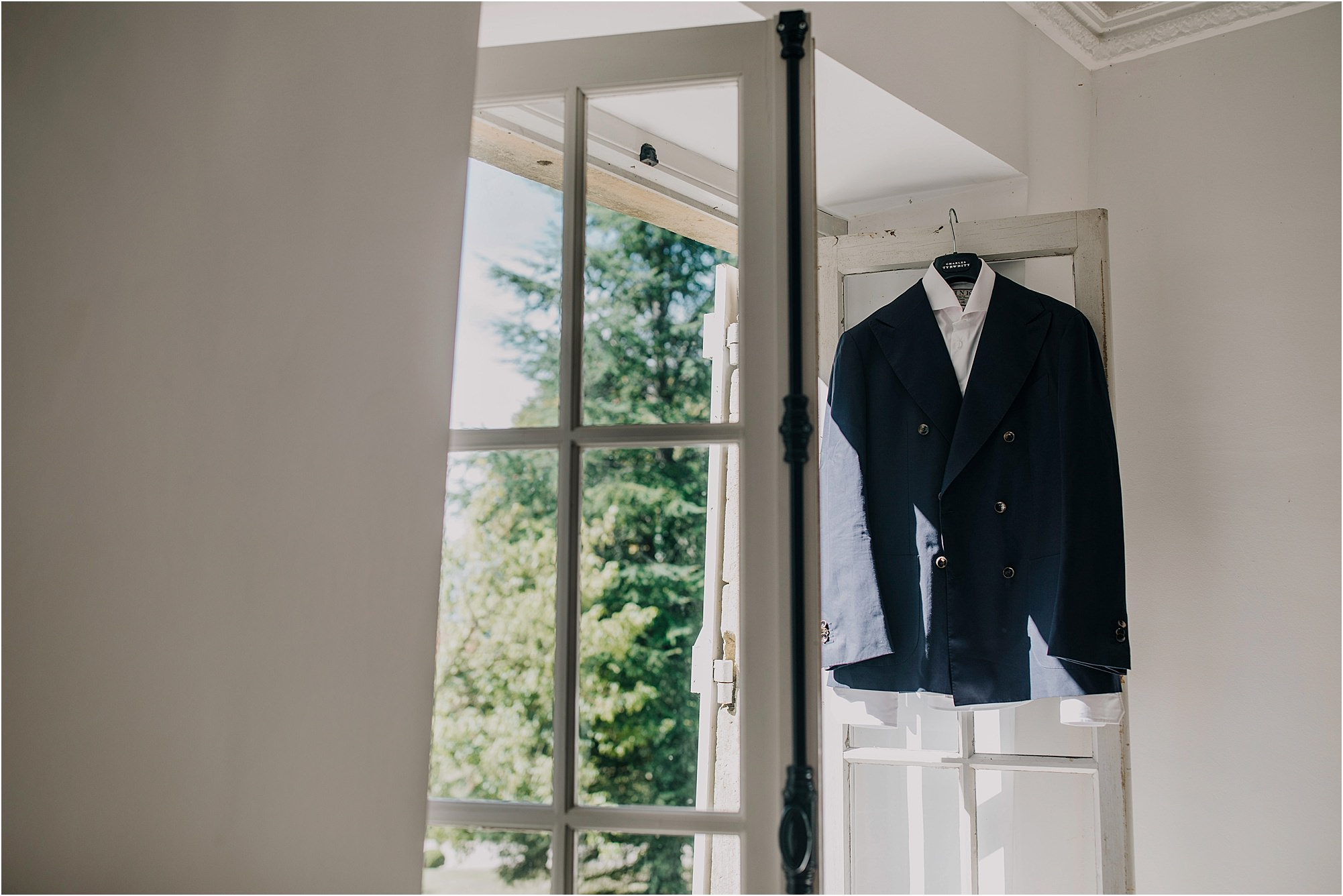 grooms suit hanging up at a chateau la durantie wedding