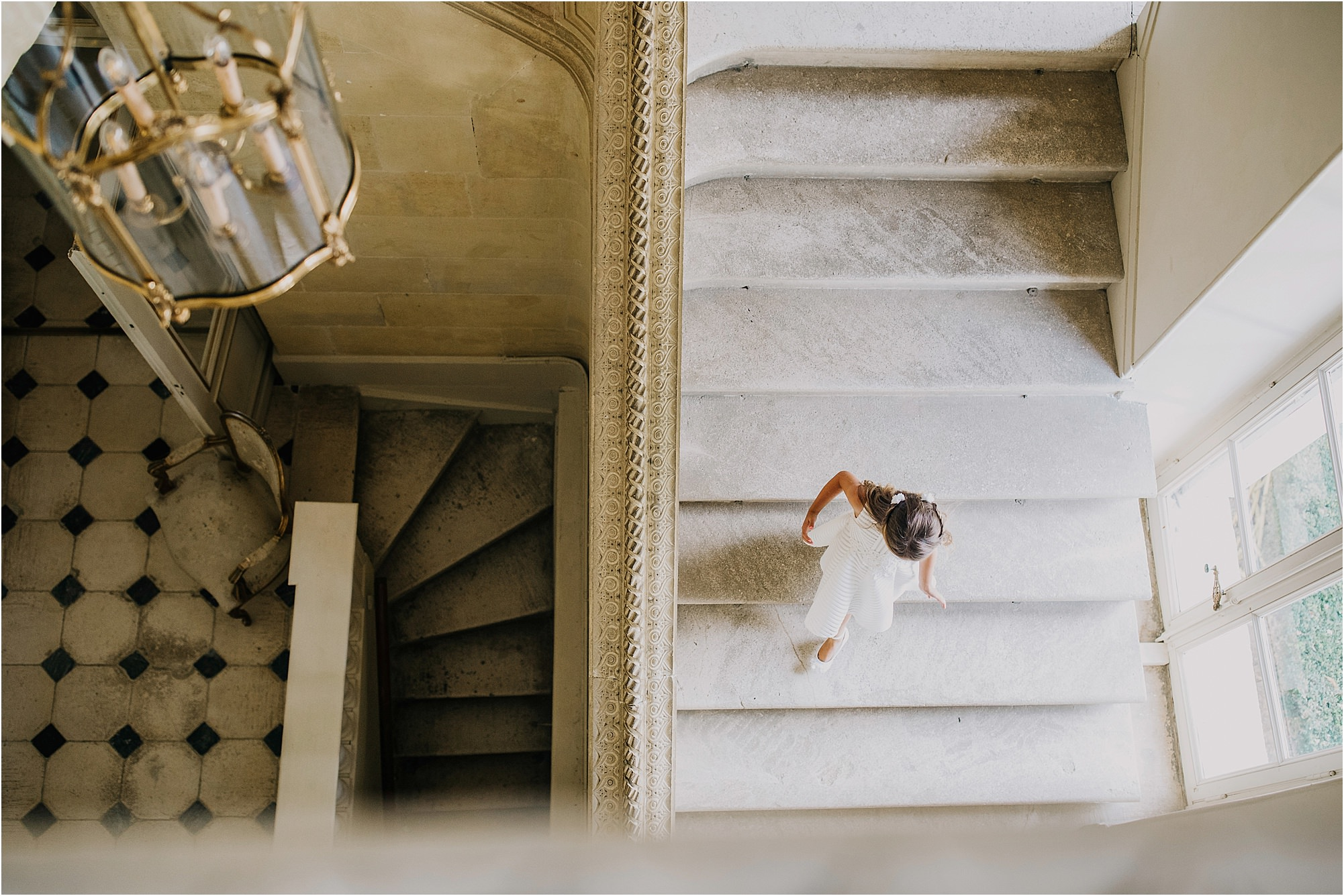 girl running down the stairs at chateau la durantie