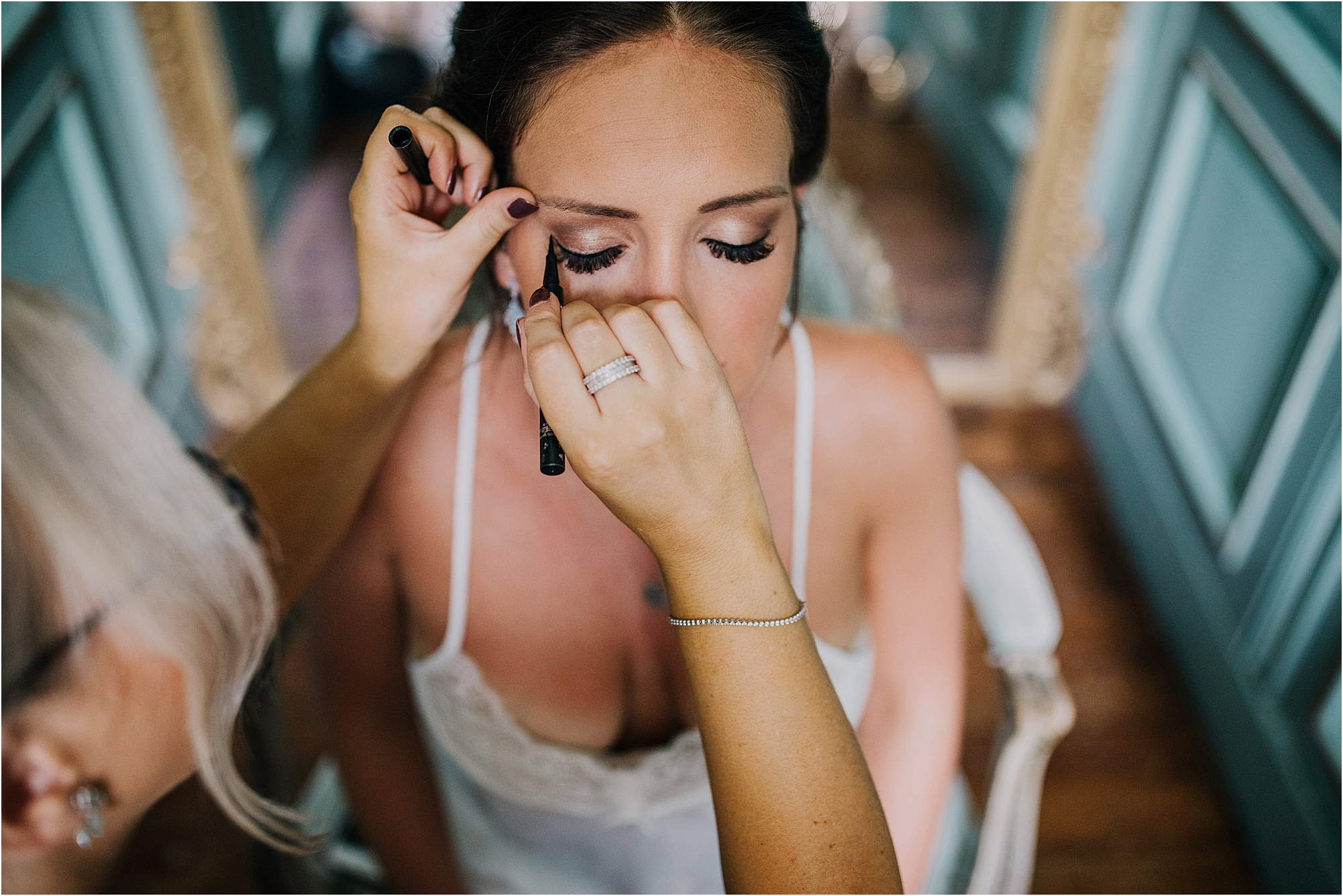 bride having make up done during bridal prep at a chateau la durantie wedding