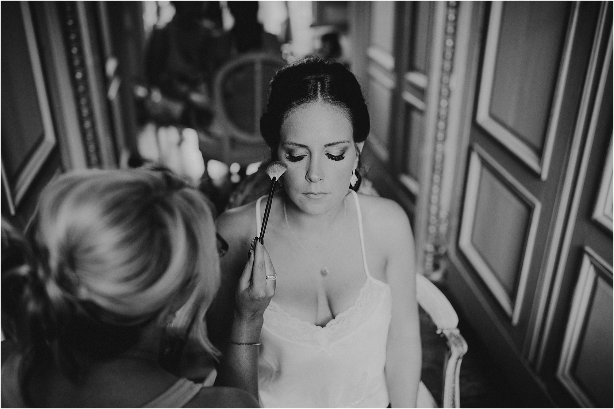black and white of bride having make up done at a chateau la durantie wedding