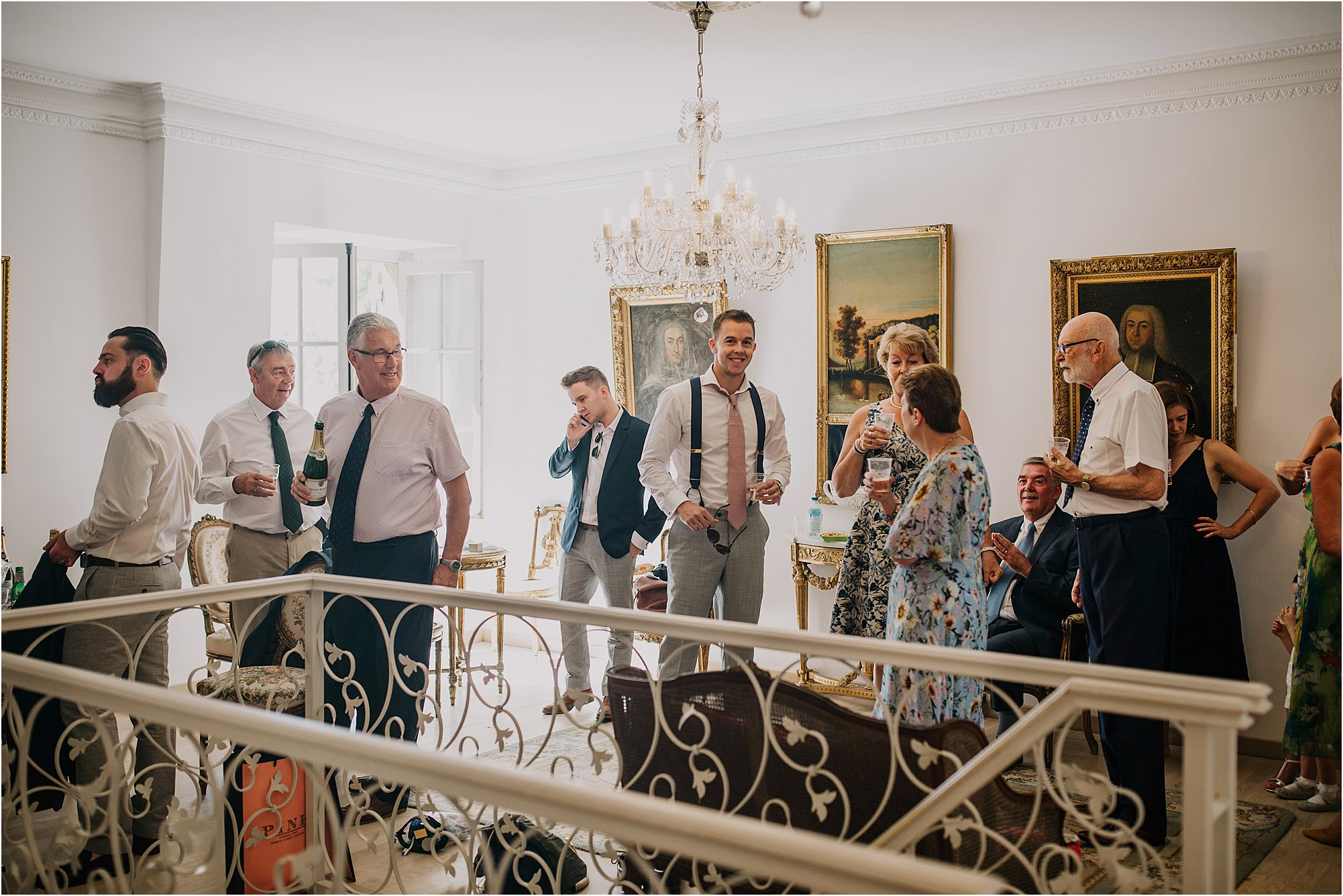 groom in the coach house with groomsmen at a chateau la durantie wedding