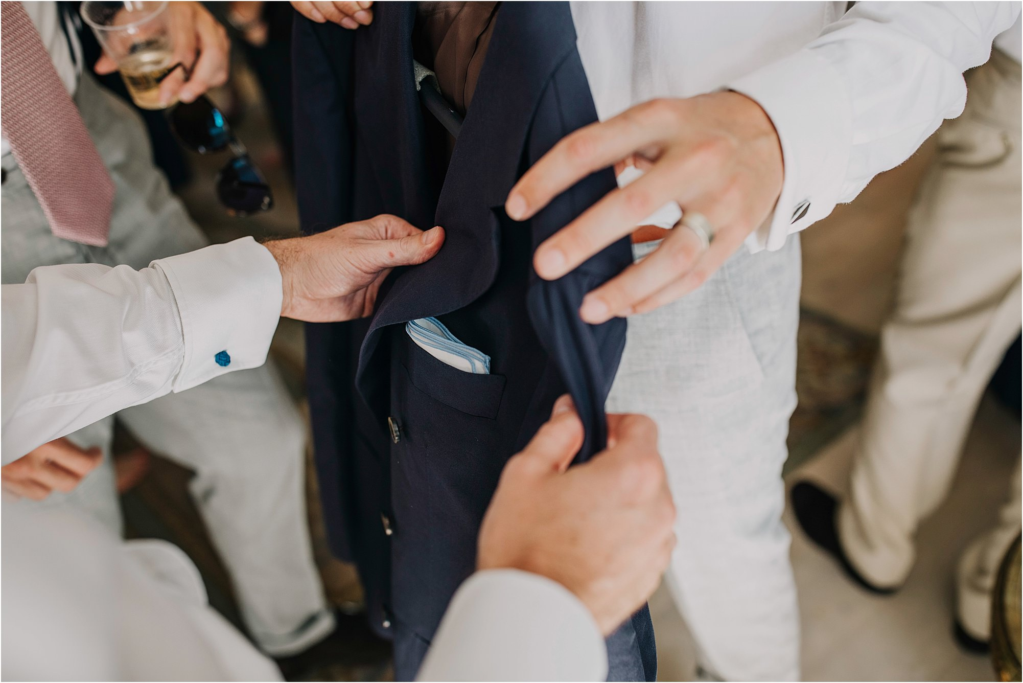 putting the blue and white pocket square in suit at a chateau la durantie wedding