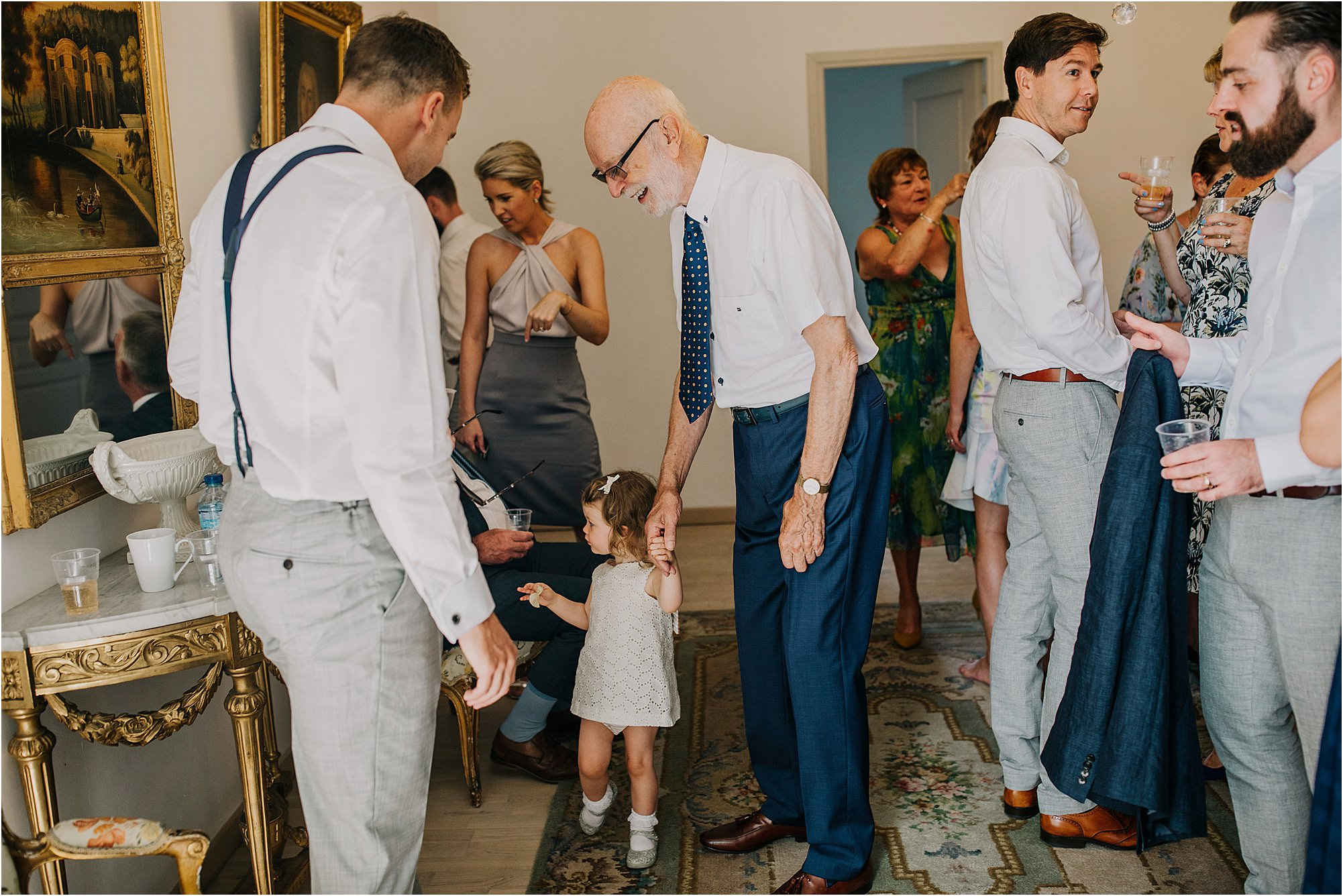 little girl holding great grandads hand at a chateau la durantie weding