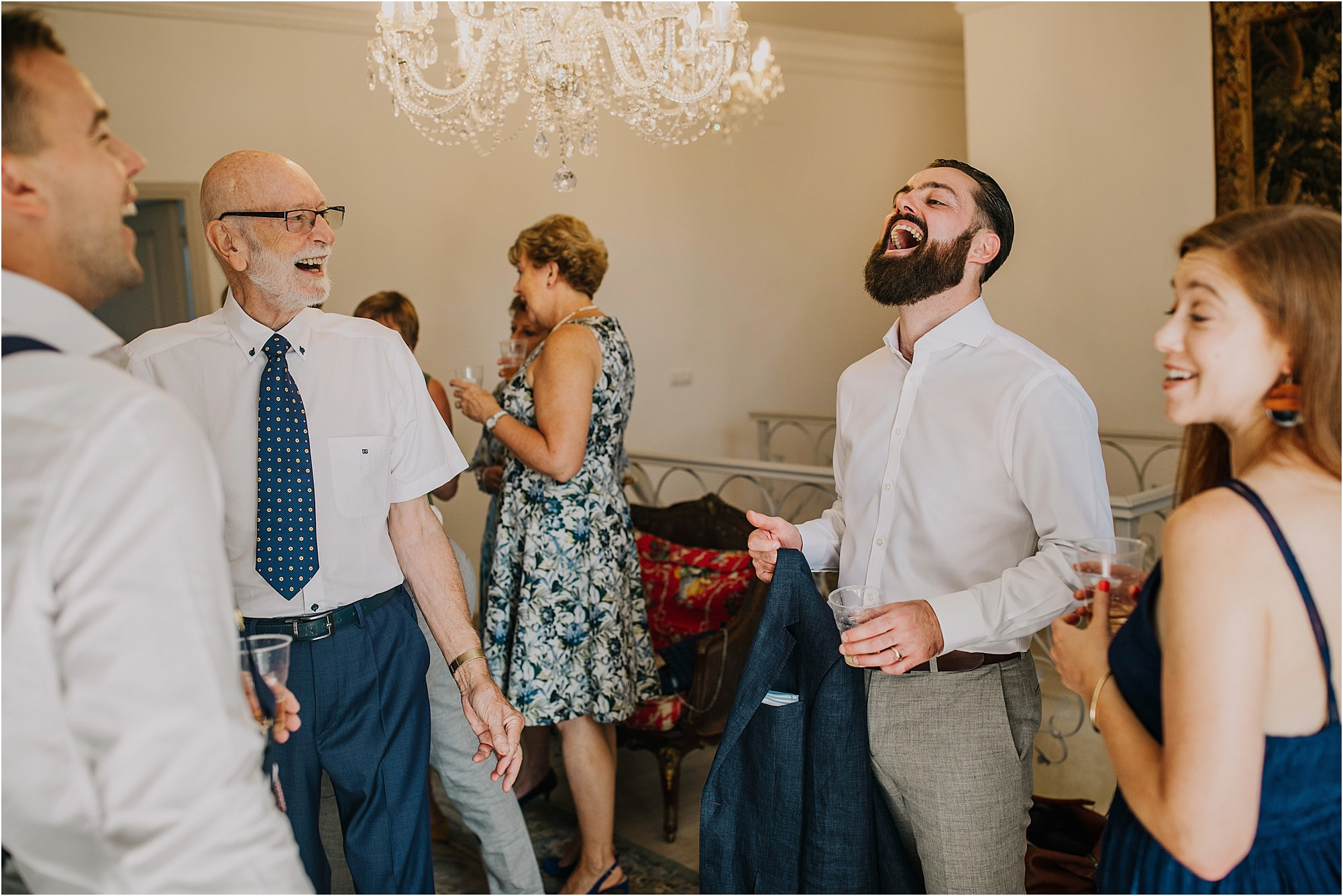 groomsmen laughing at a chateau la durantie wedding