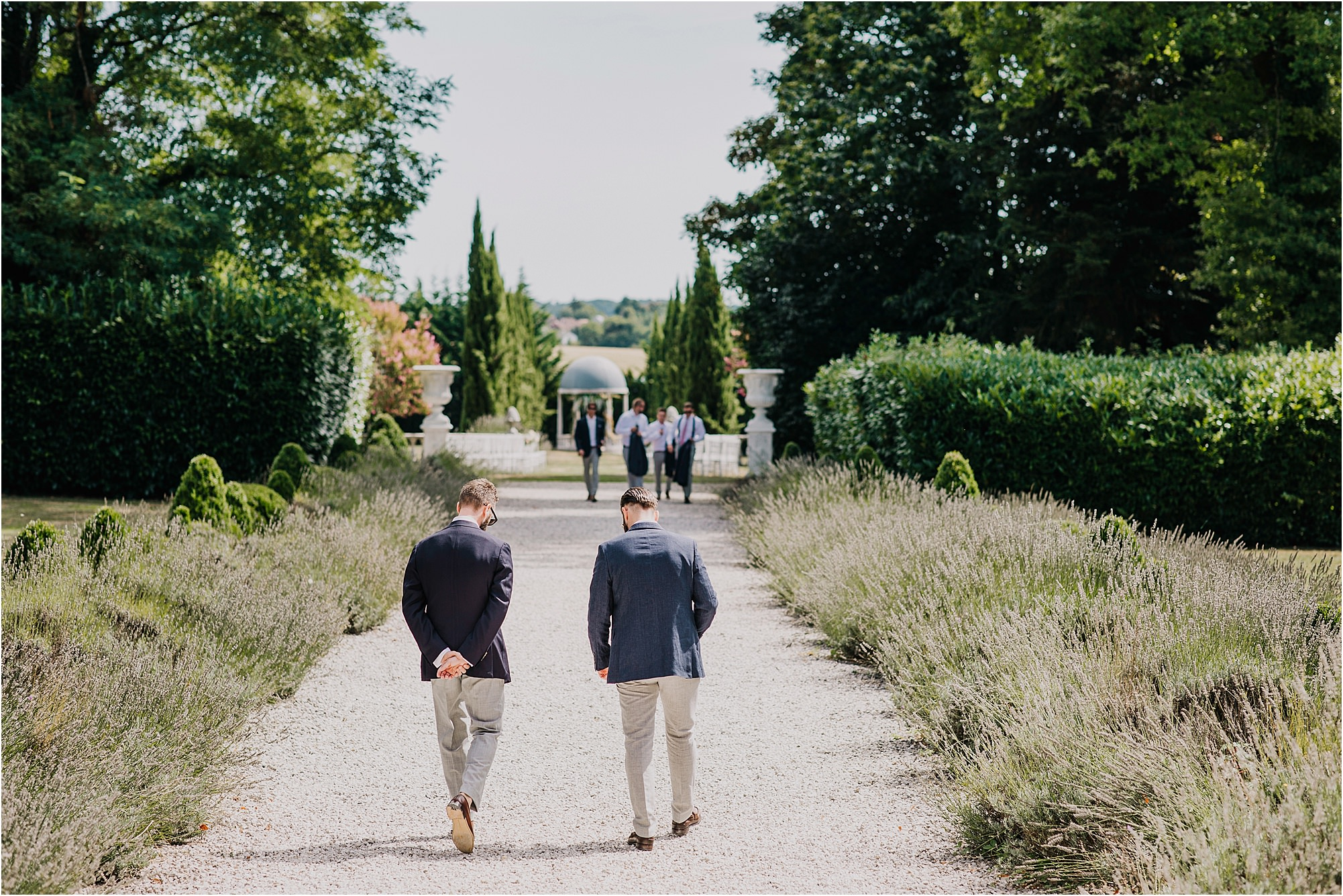 groomsmen walking down the path at chateau la durantie