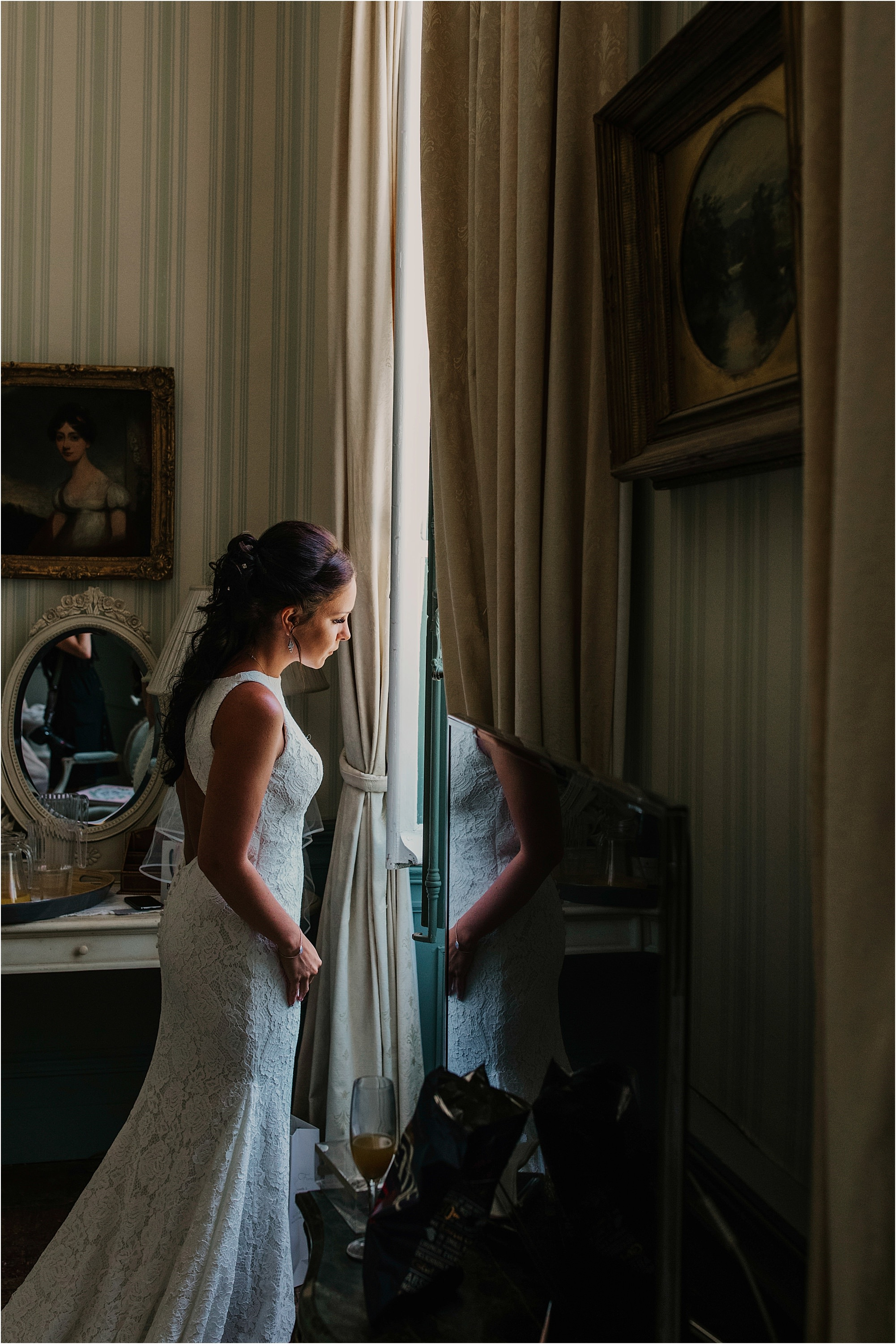 bride looking out of the window at chateau la durantie