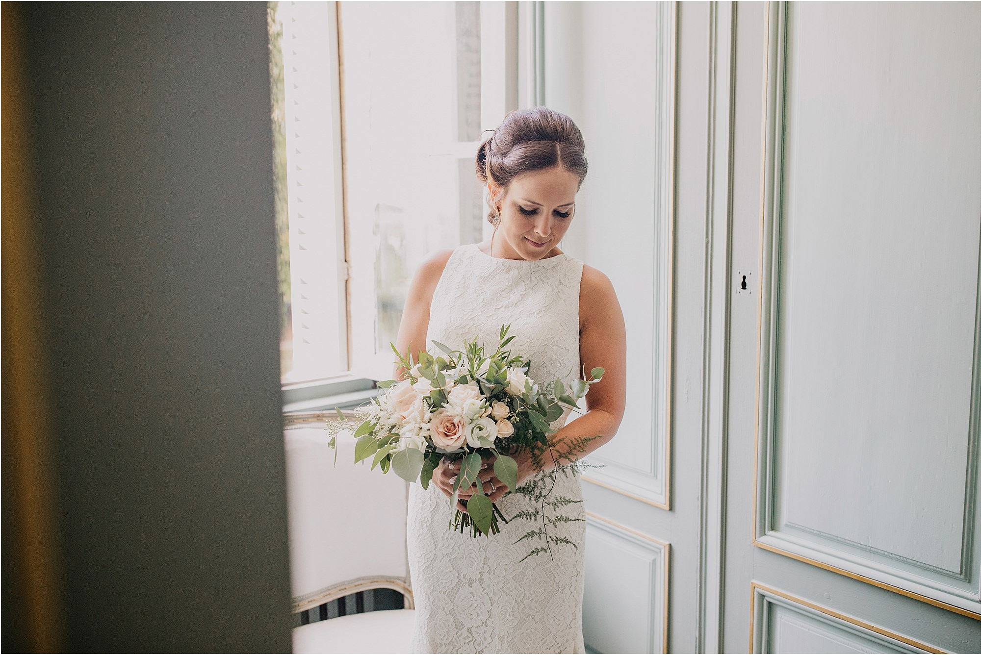 bride portrait by the window at a chateau la durantie wedding