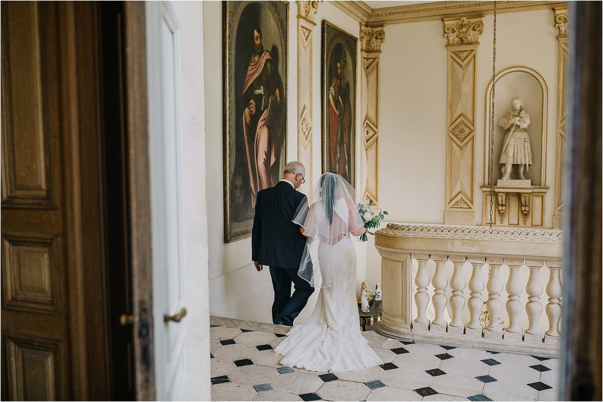 father of bride walking bride down the stairs at chateau la durantie