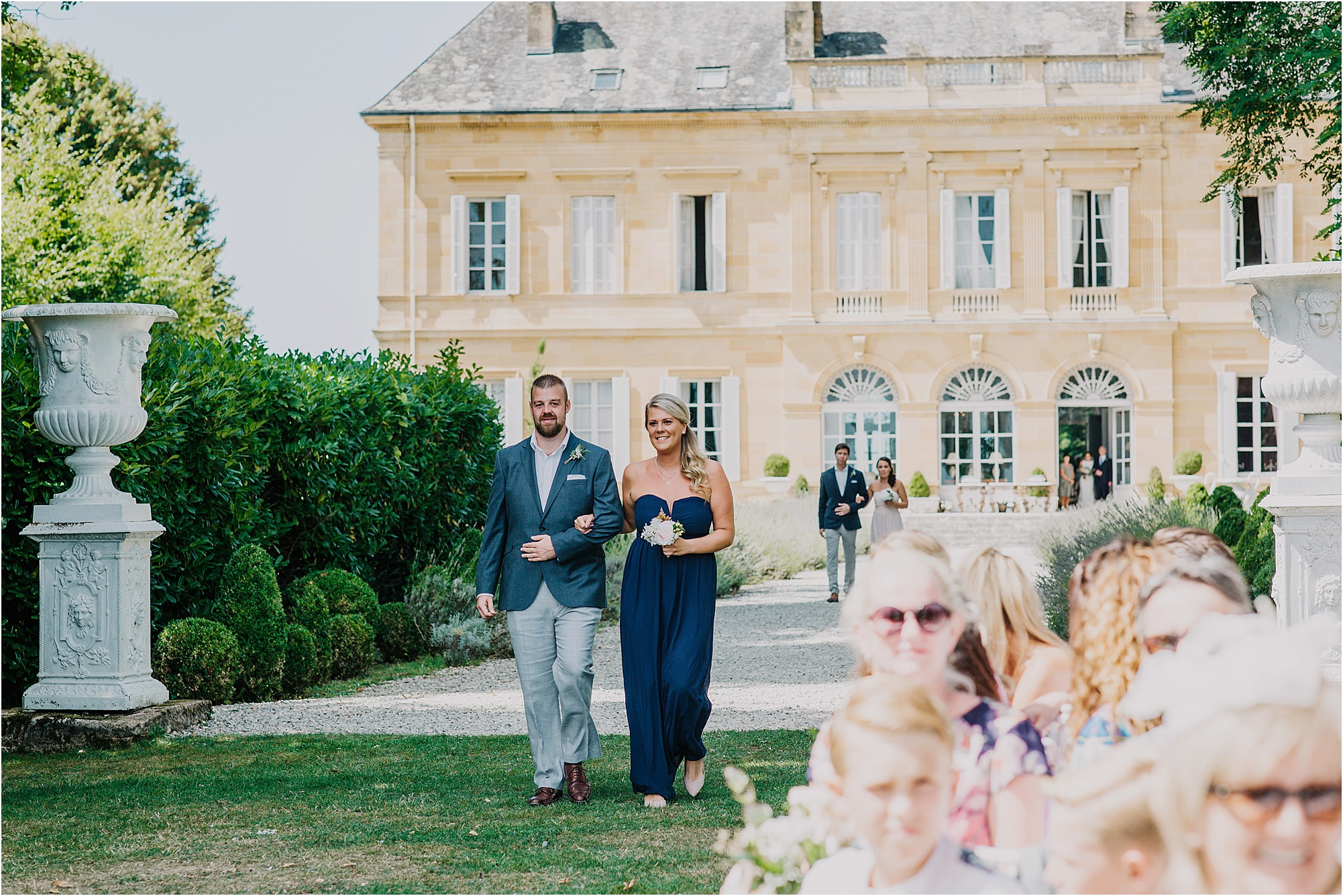 bridesmaid walking down the aisle at a chateau la durantie wedding