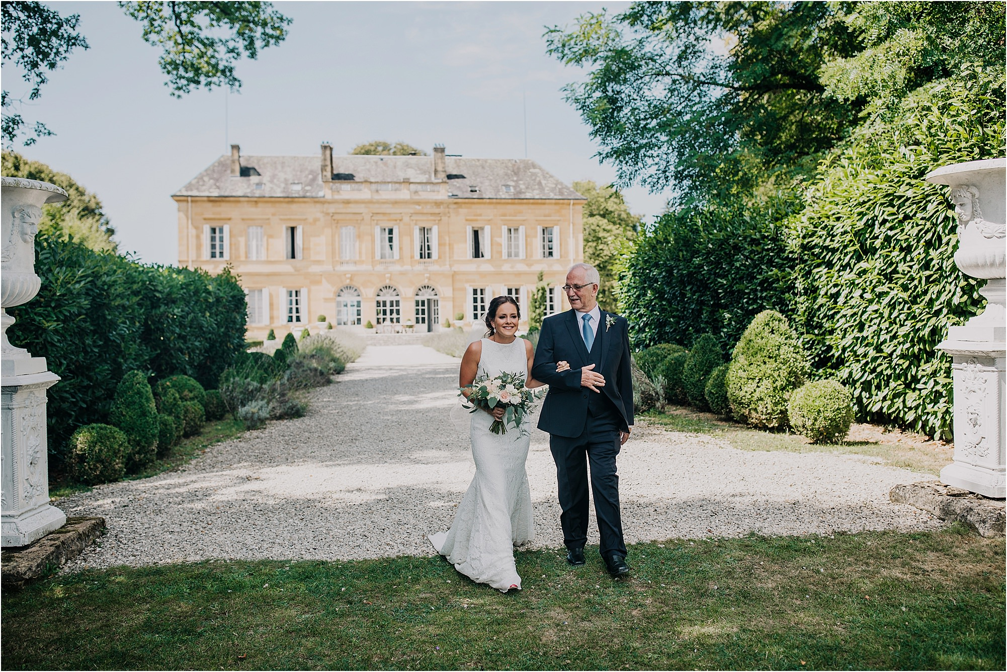 bride and father walking down aisle at an outdoor ceremony at chateau la durantie
