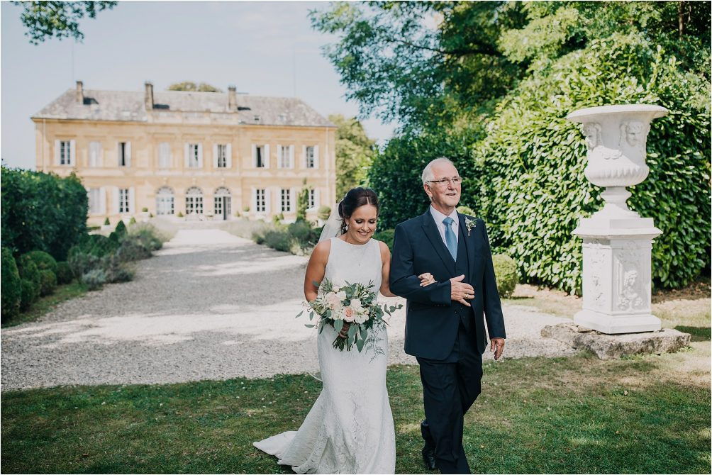 father of bride and bride walking down the aisle at a chateau la durantie wedding