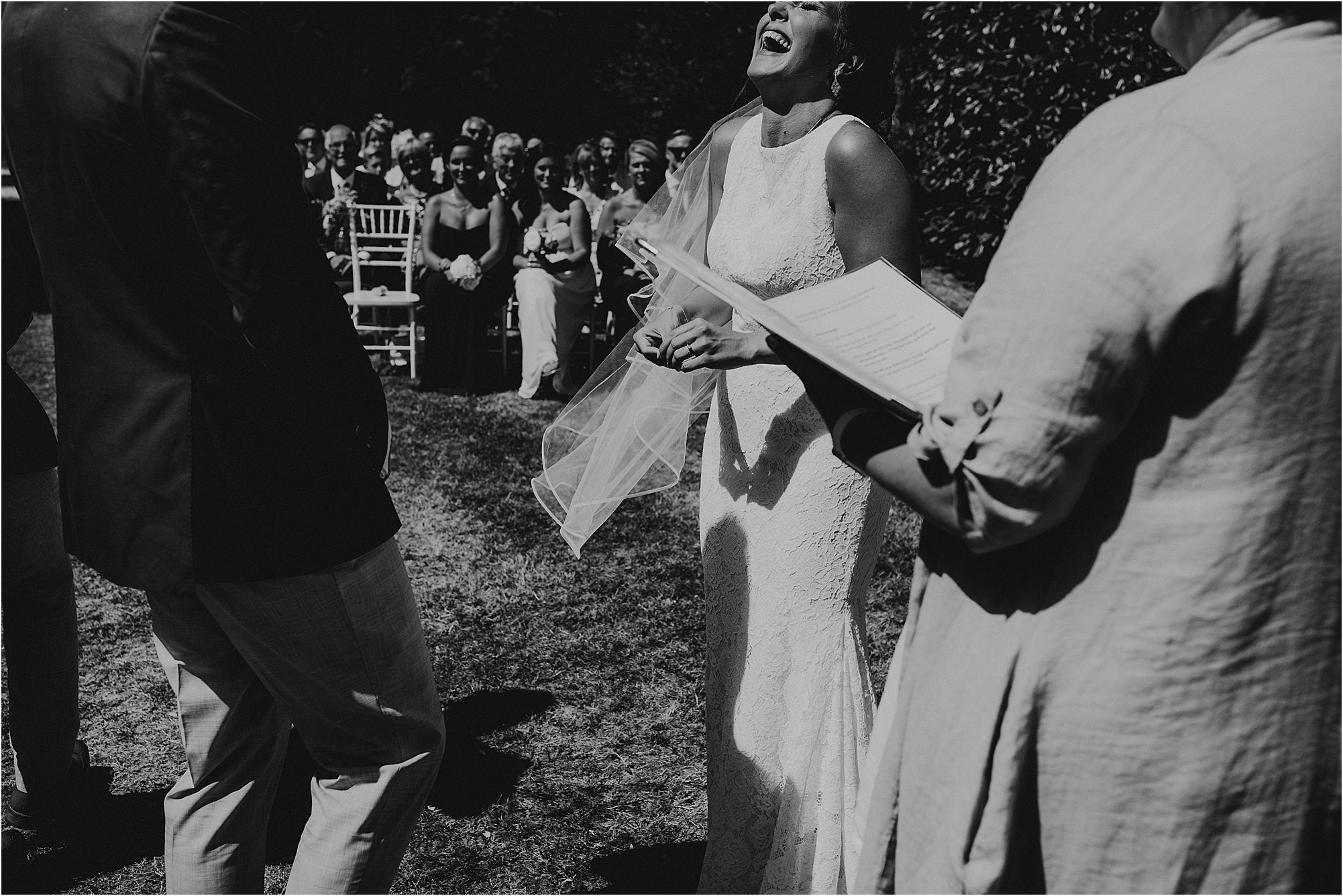 bride laughing during ring exchange at a chateau la durantie wedding