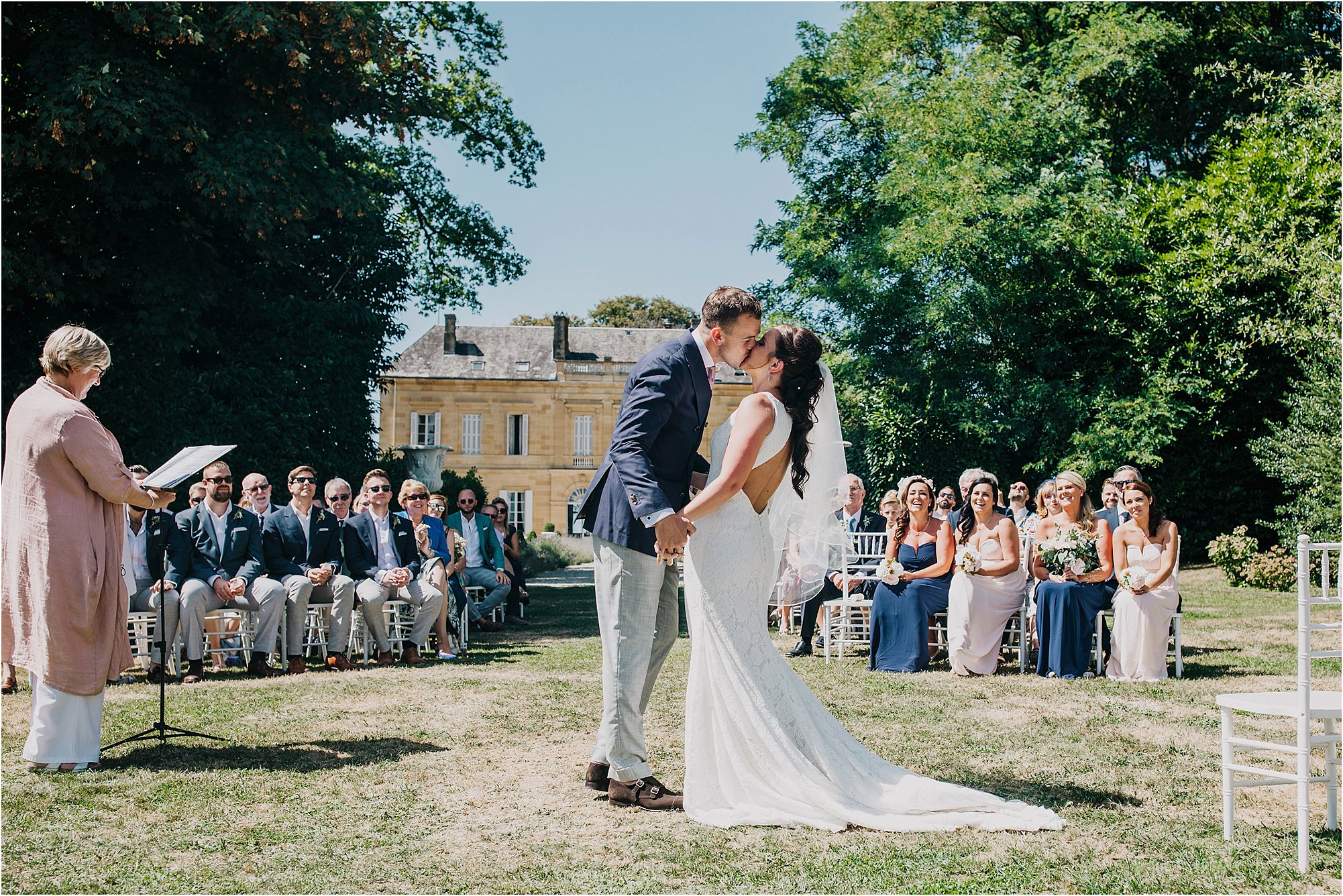 the first kiss at an outdoor ceremony at chateau la durantie