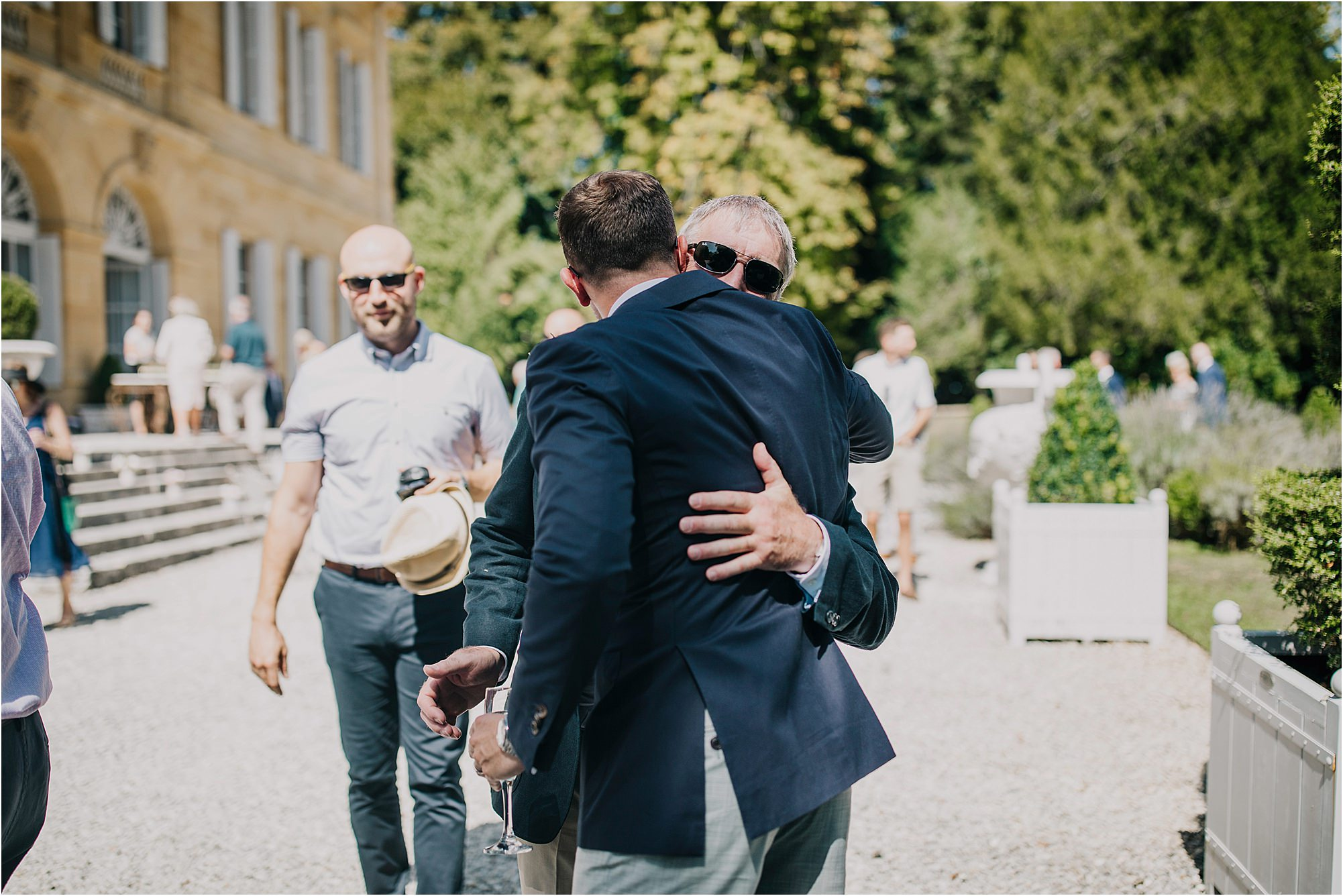father of groom and groom hugging at chateau la durantie