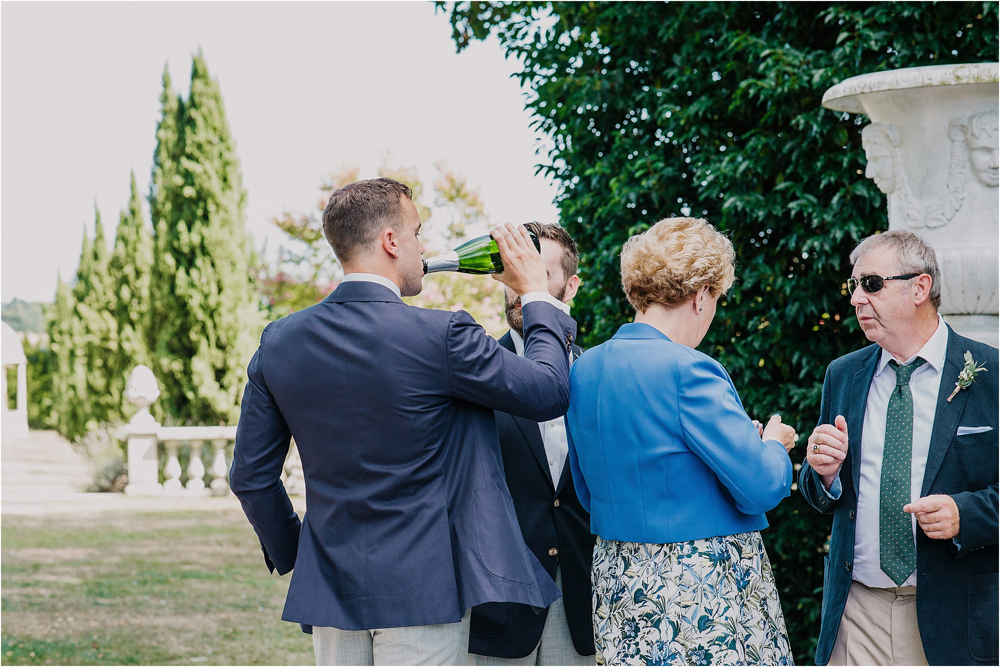 groom drinking champagne from bottle at a chateau la durantie wedding