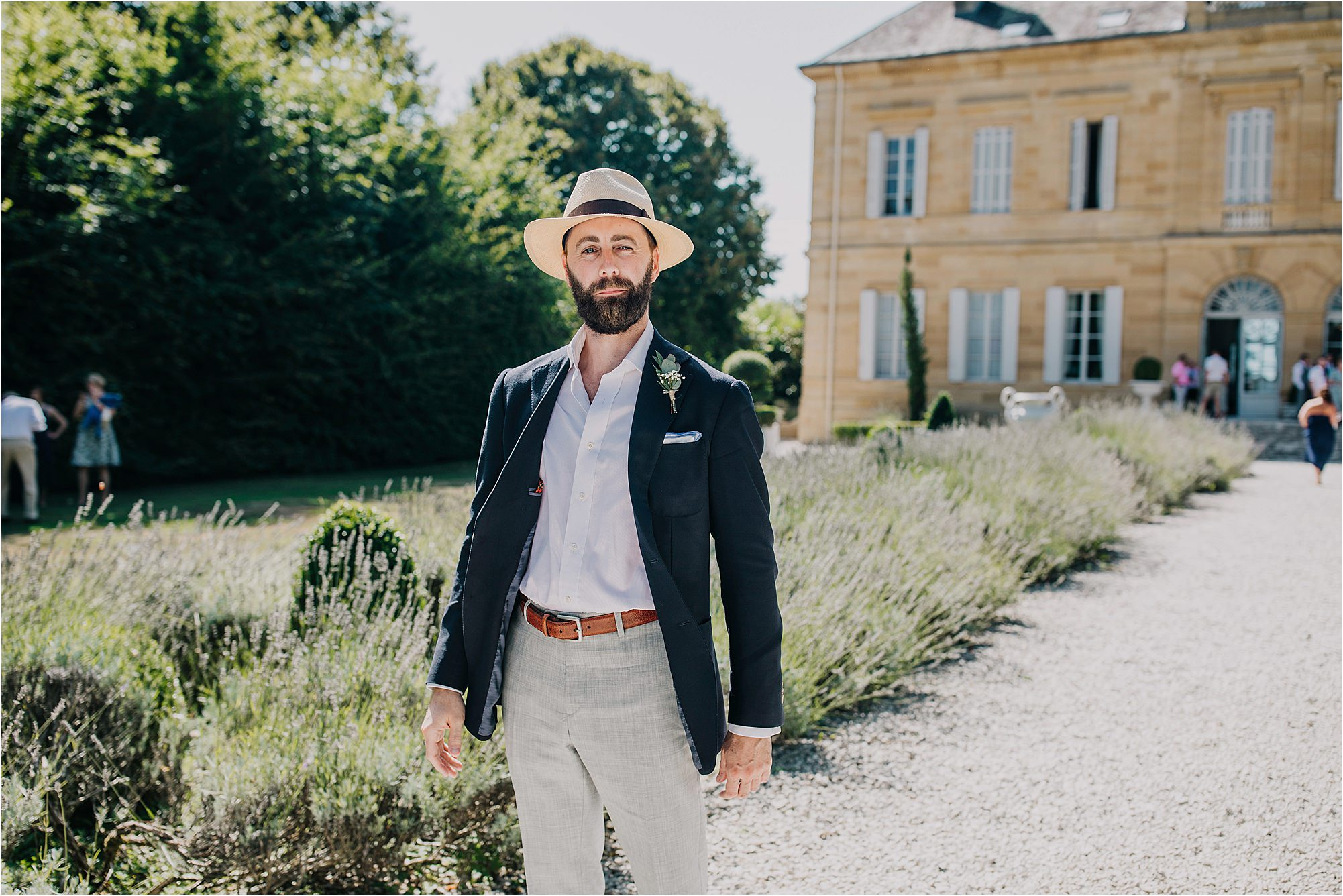 man with boater at chateau la durantie wedding