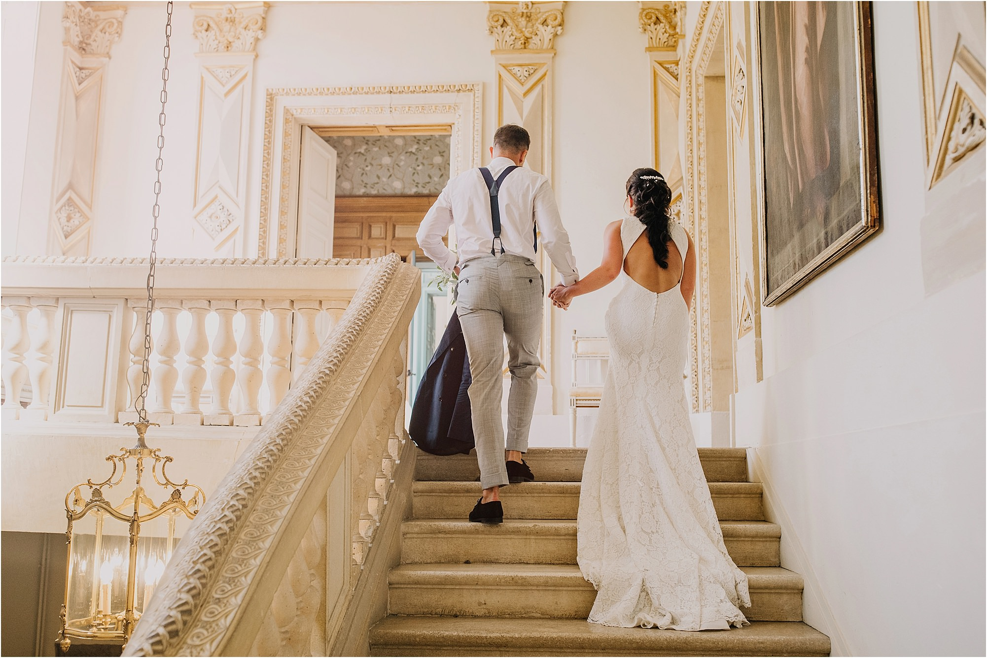 bride and groom on stairs at a chateau la durantie wedding