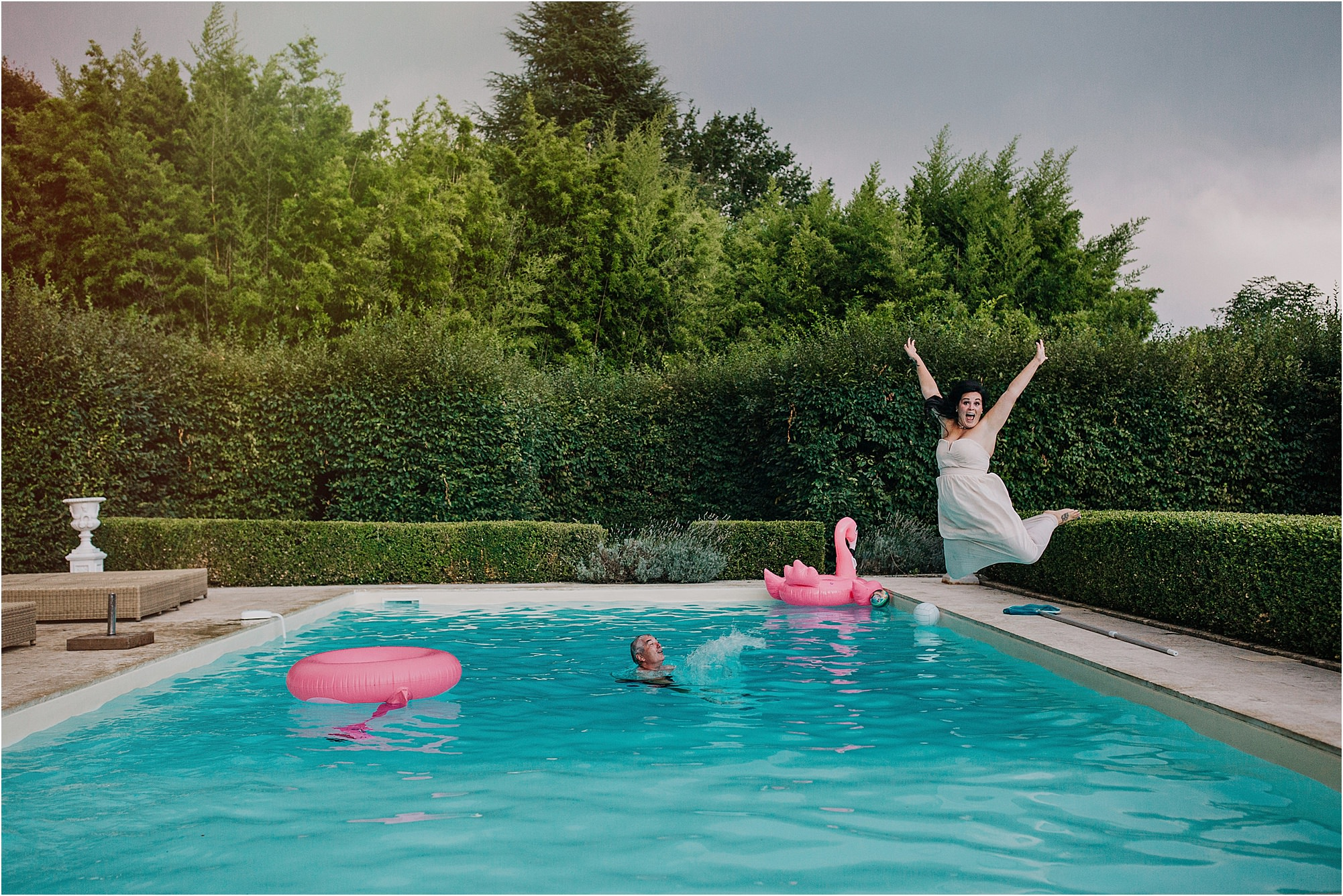 bridesmaid jumping in pool at chateau la durantie