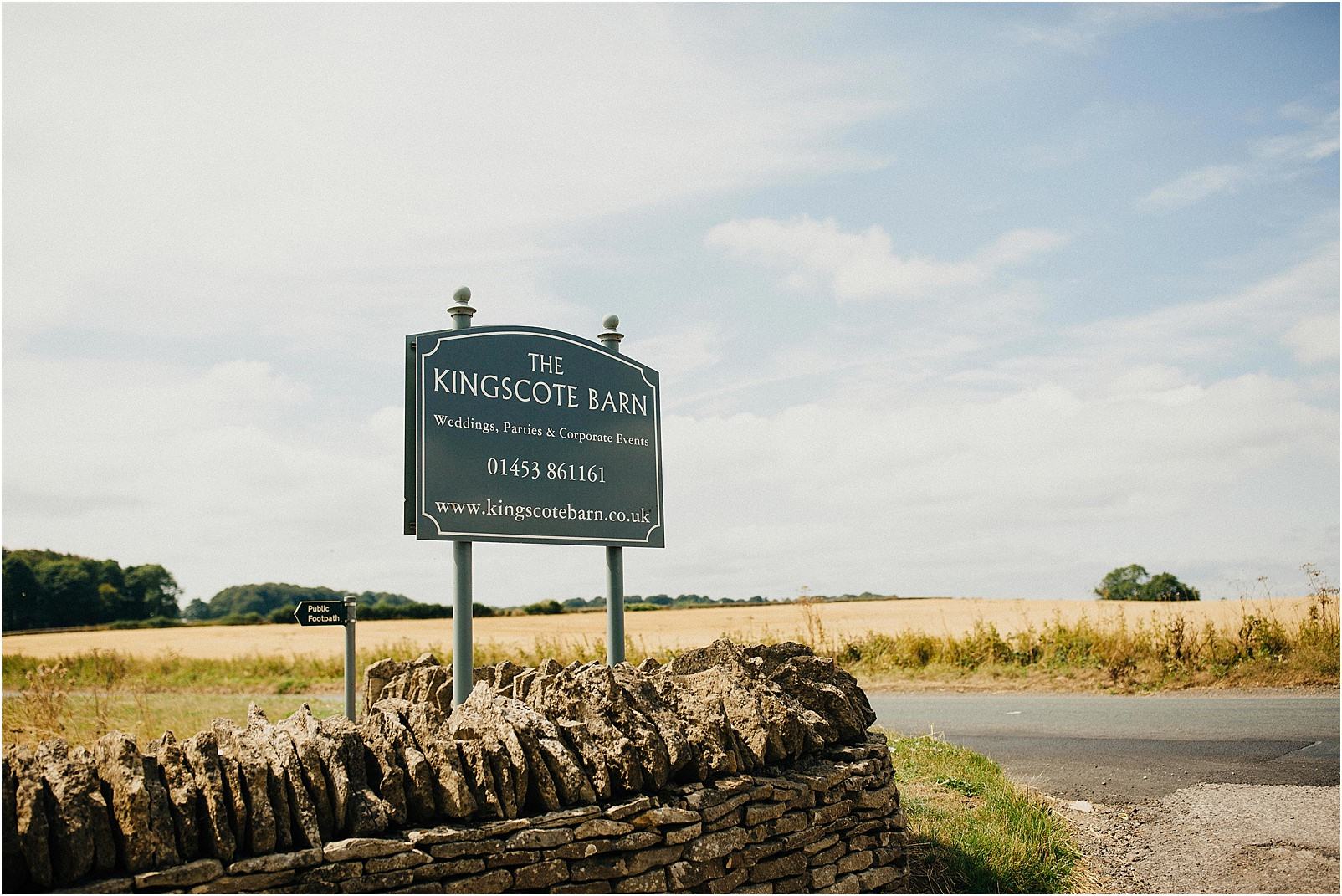 Kingscote Barn sign at the road