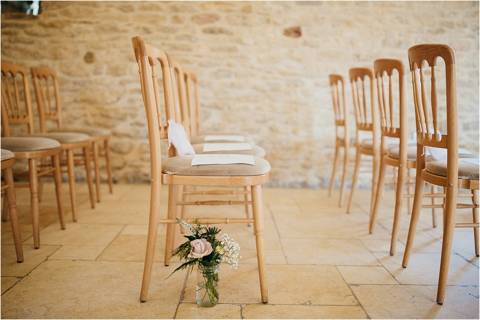 indoor ceremony at Kingscote Barn