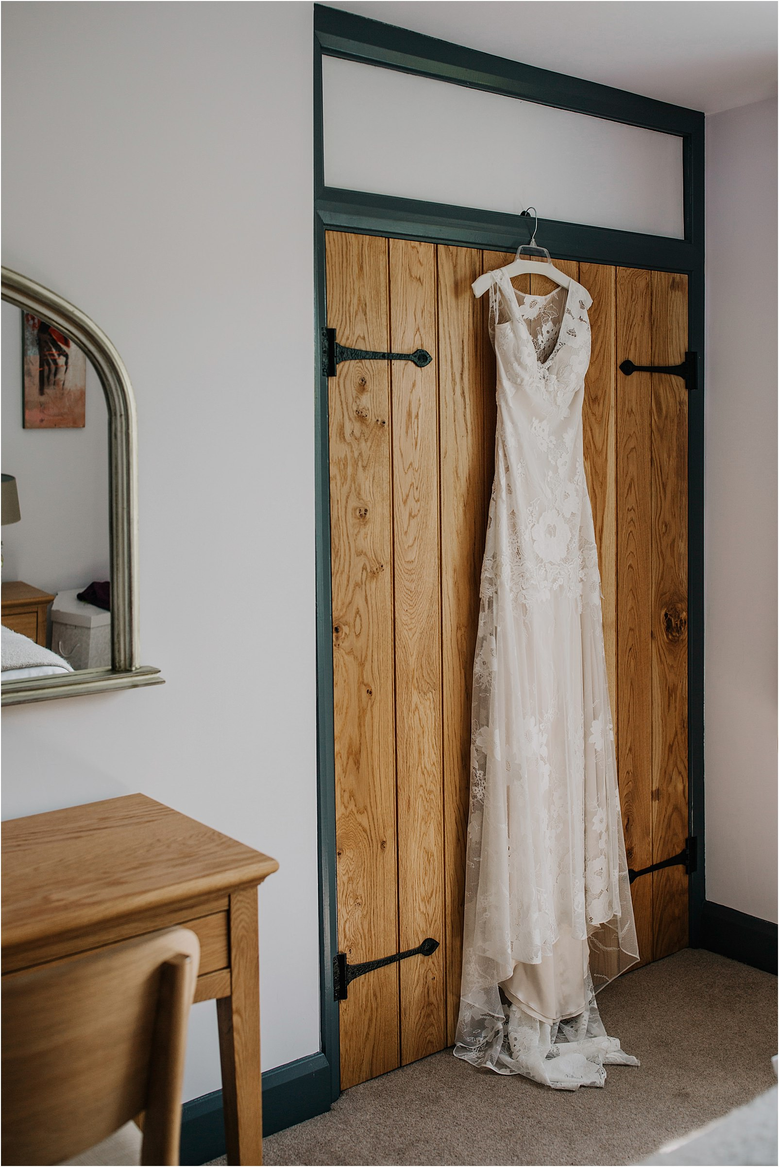 Claire Pettibone dress hanging at Spring Cottage at Kingscote Barn