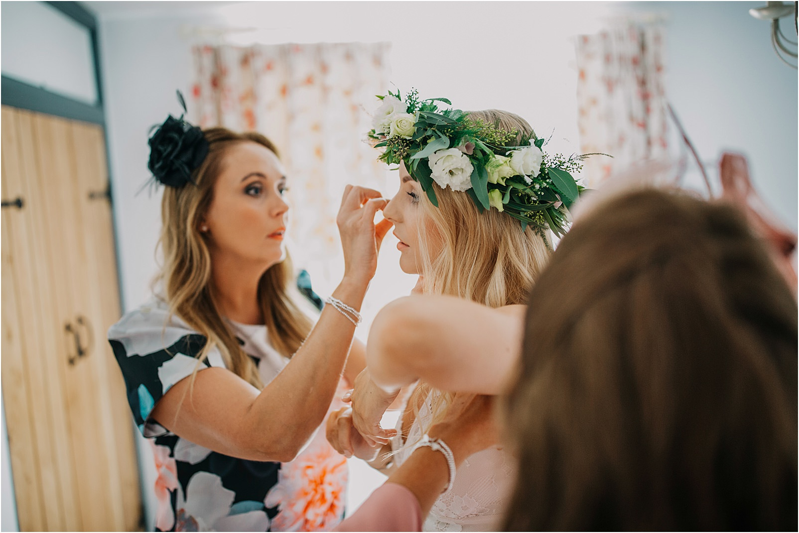 final touches with flower crown before Kingscote wedding