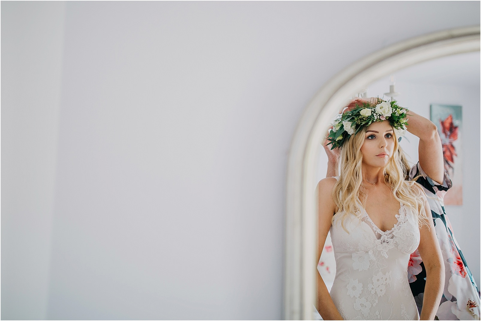 bride in front of mirror at Kingscote Barn