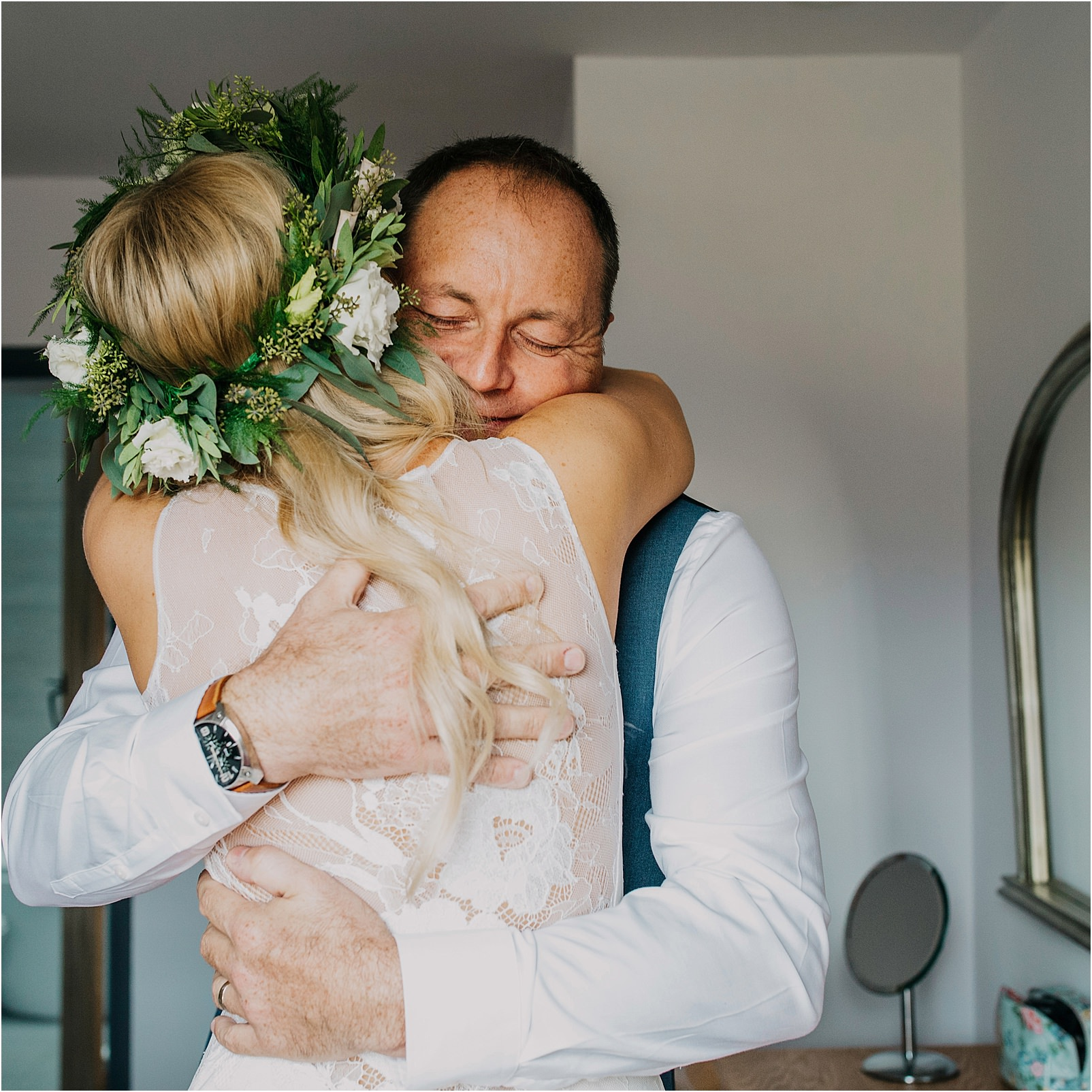 father of bride hugging bride before ceremony at Kingscote Barn