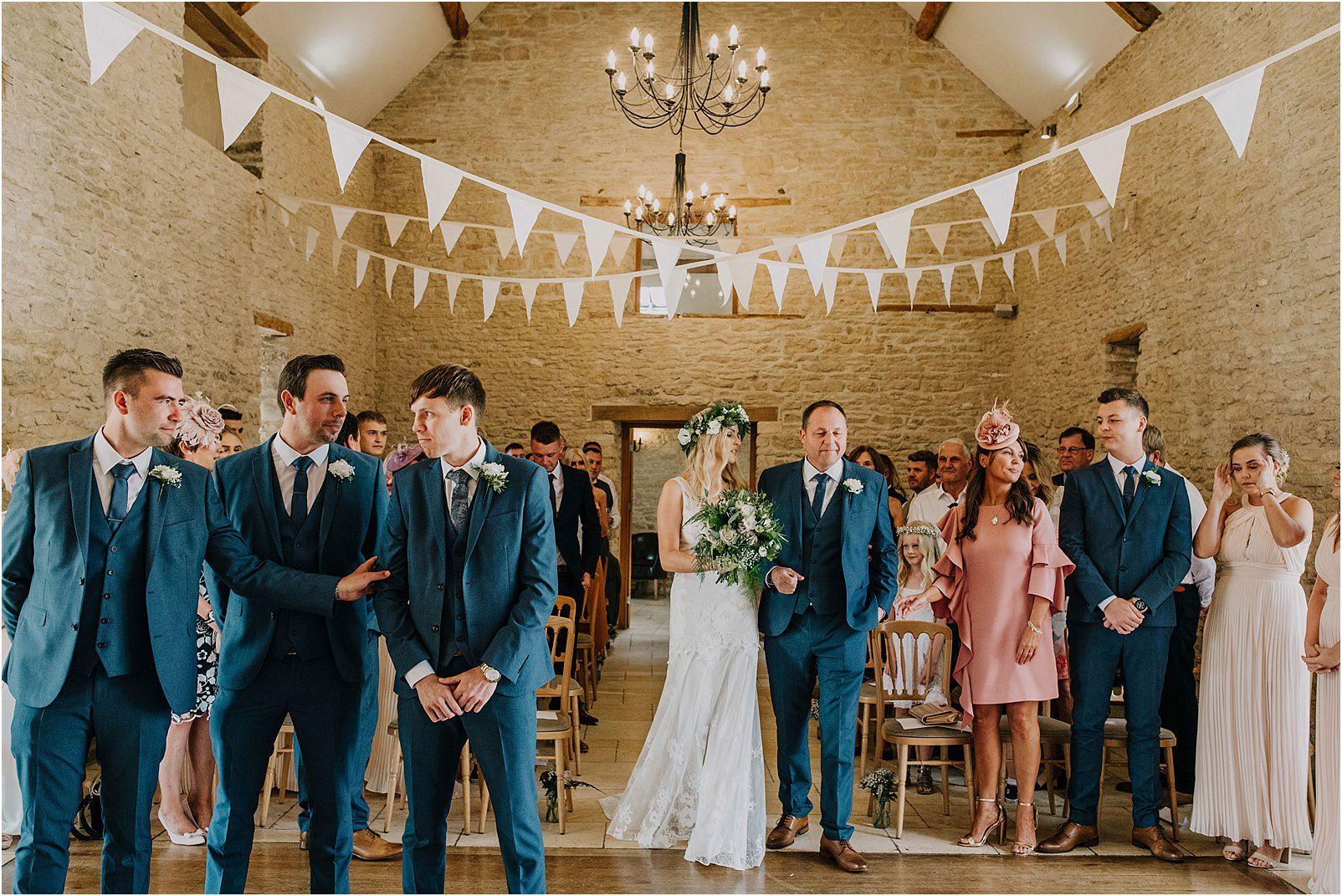 bets man reassuring groom at Kingscote Barn
