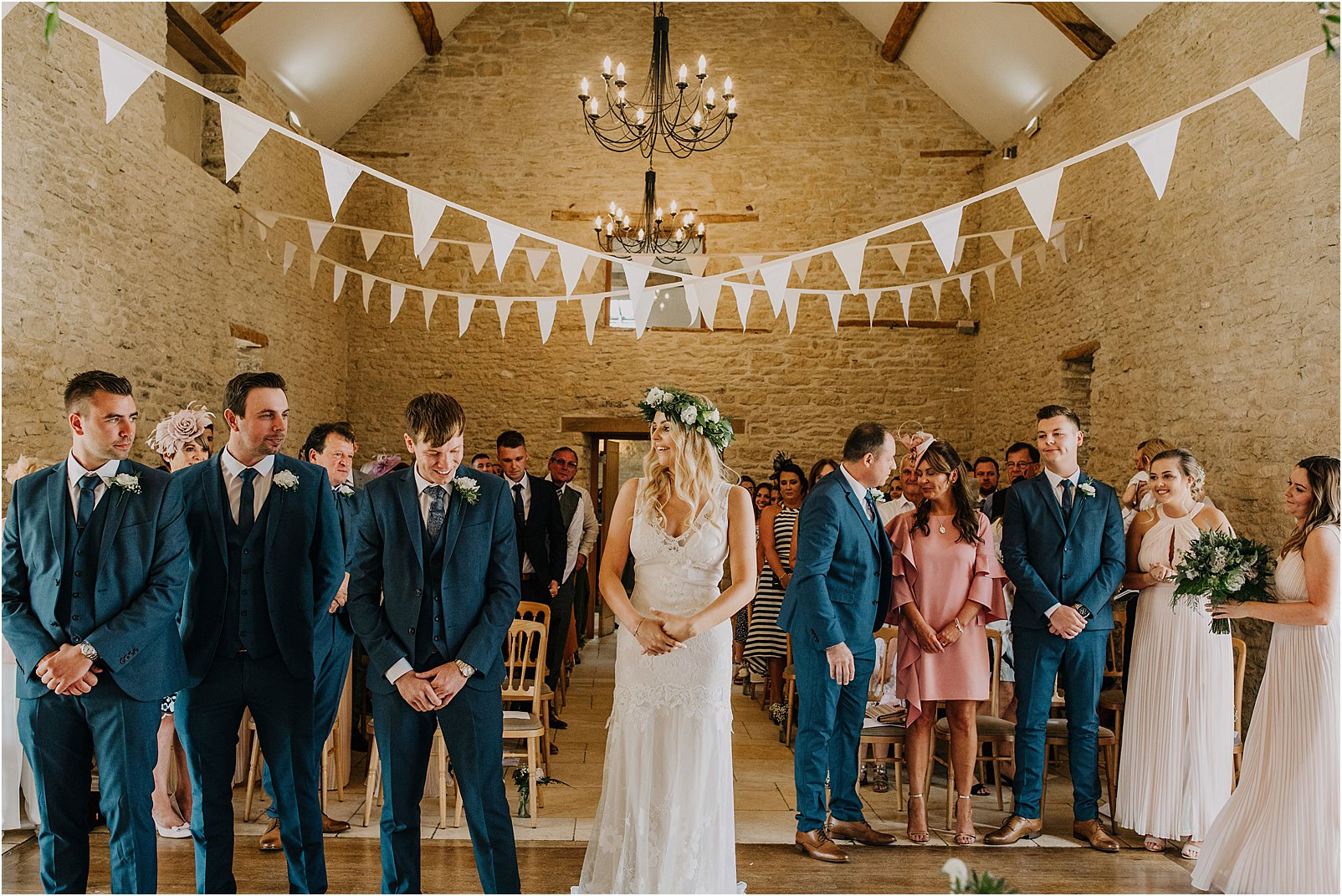 Bride and groom seeing each other for first time at Kingscote Barn