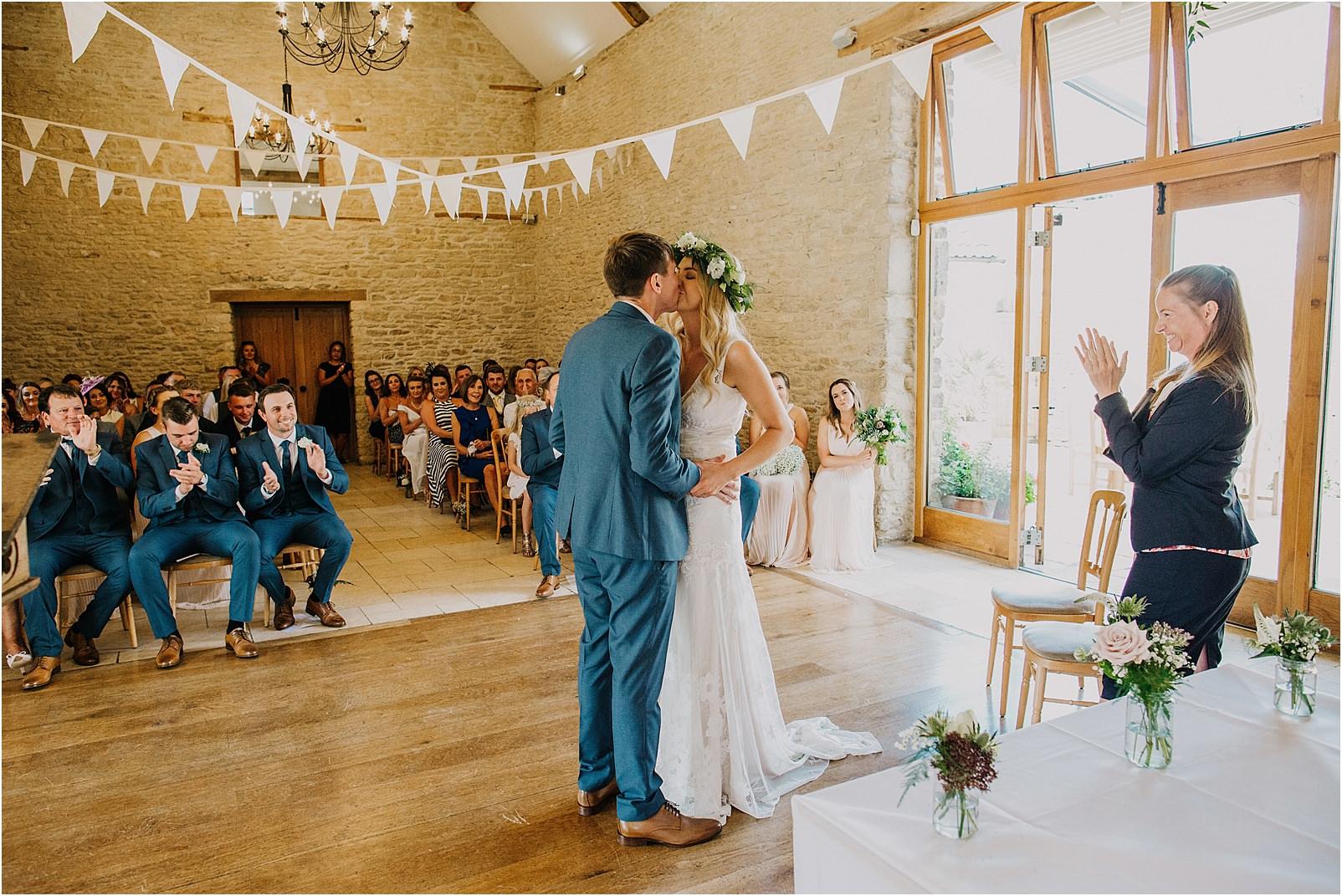 first kiss at Kingscote Barn wedding
