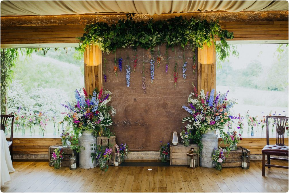 milk churn wedding flowers Elmore Court