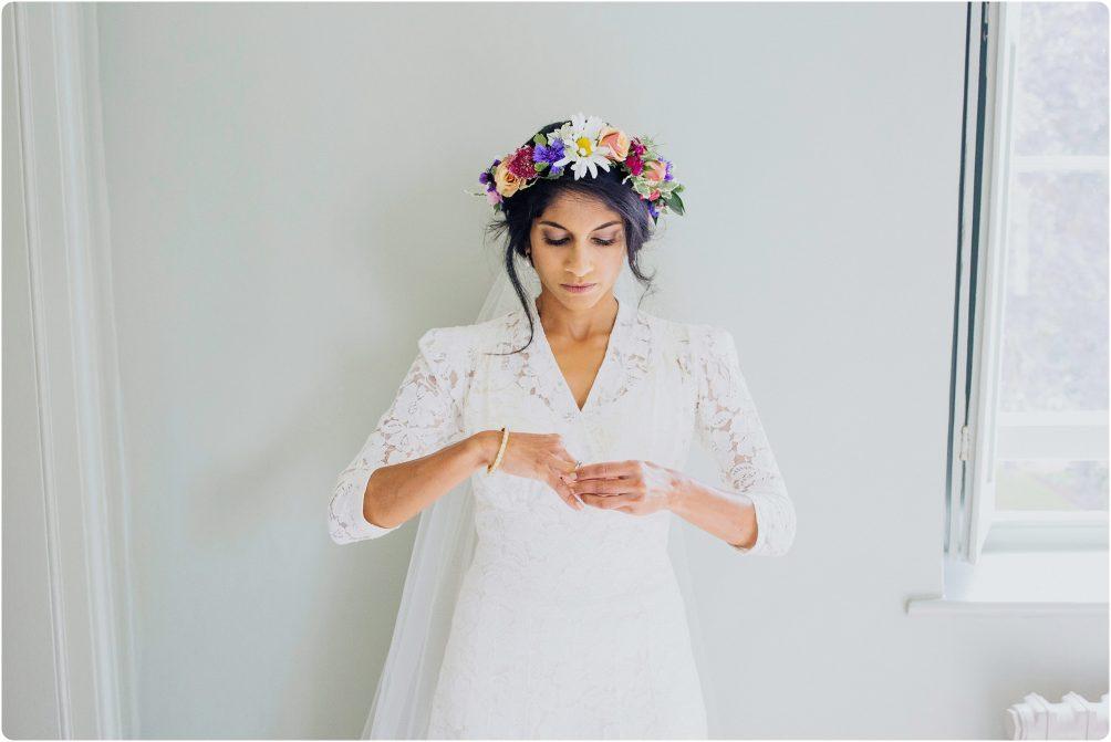 bride wearing flower crown at an Elmore Court wedding