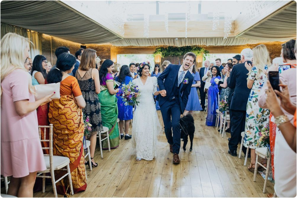 couple walking back down the aisle at a Elmore Court wedding