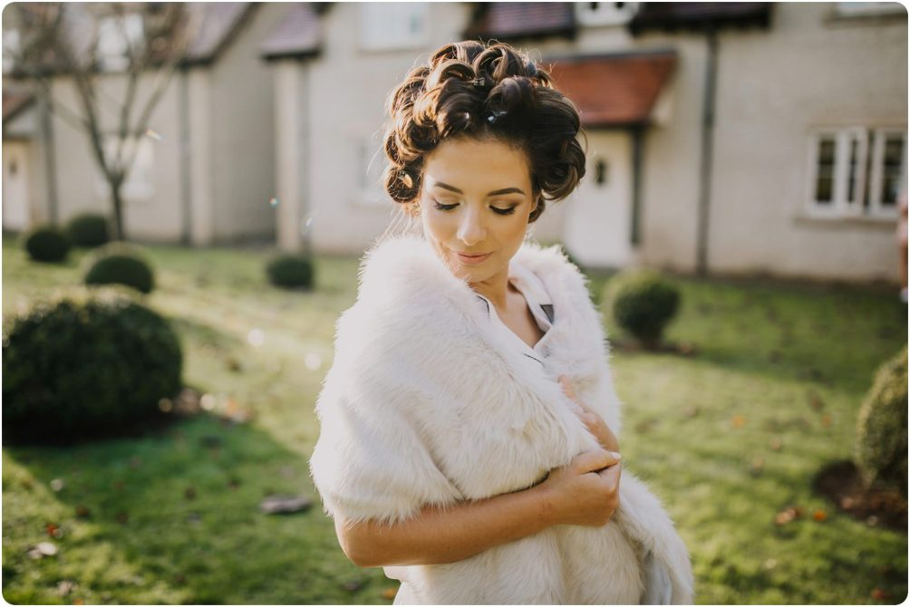 bride with curlers in at a kingscote barn wedding