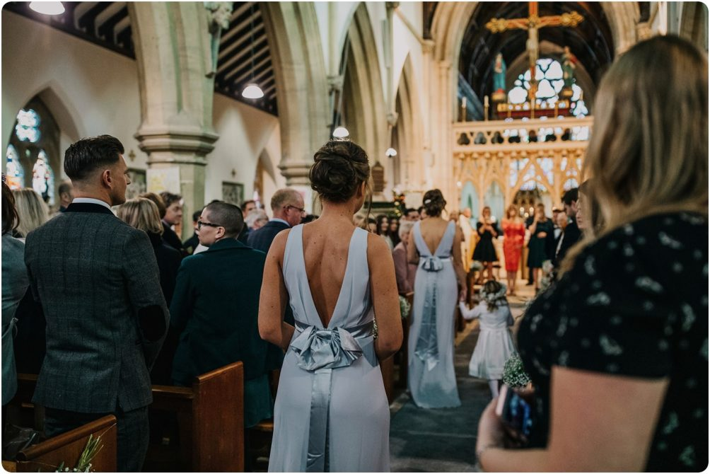 bridesmaids walking down aisle at a wnodchester priory church