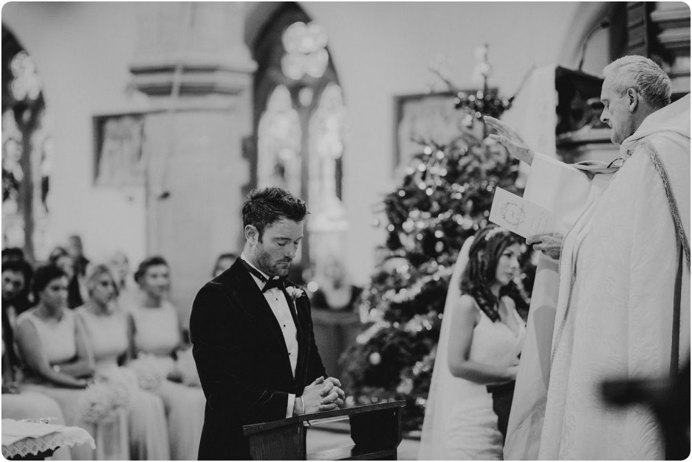 bride and groom saying prayers at a woodchester priory