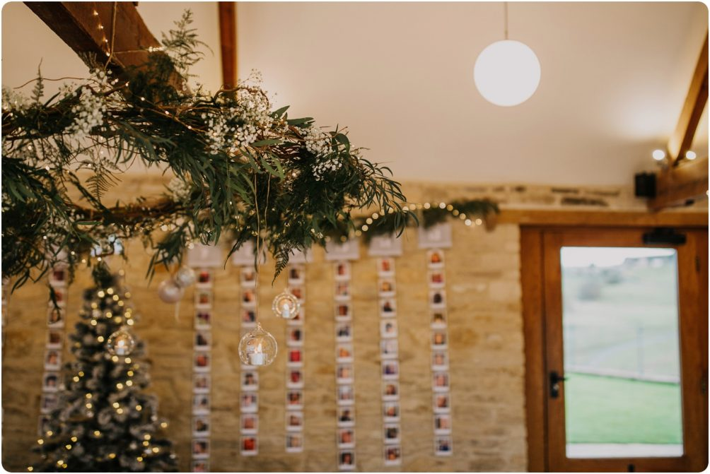 hanging garland from wilde bunch at kingscote barn