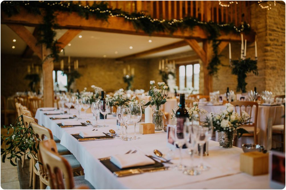table set up at a kingscote barn wedding