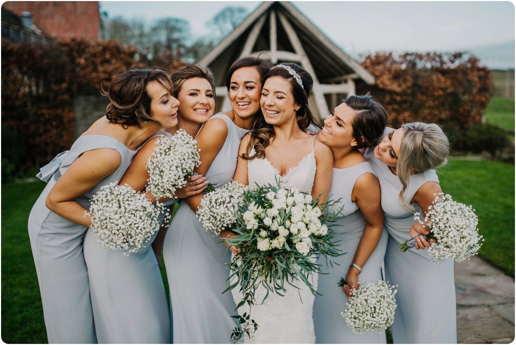 bride and bridesmaids at aa kingscote barn wedding