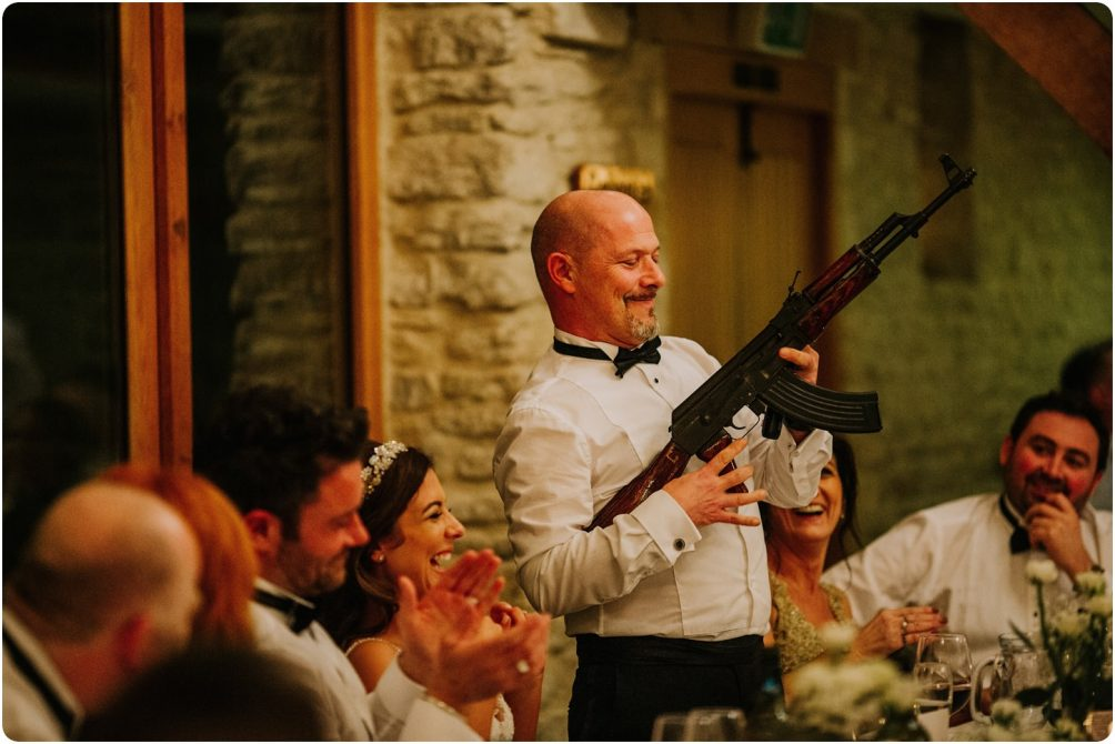 father of bride with an ak47 at a kingscote barn wedding