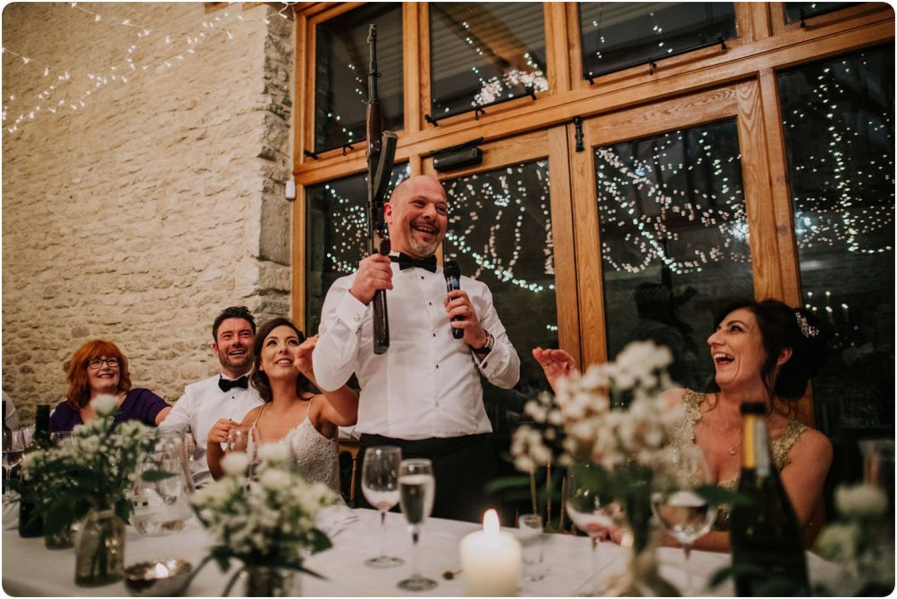 father of bride with ak47 during his speech at a kingscote barn wedding