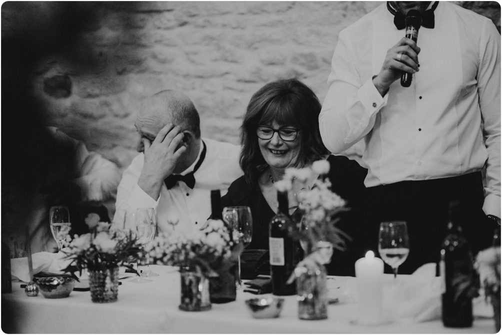 father of the groom getting emotional at a kingscote barn wedding