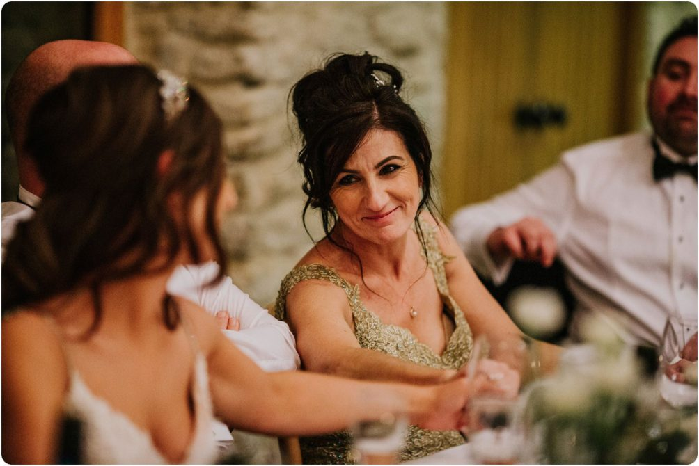 mum looking at daughter at a kingscote barn wedding
