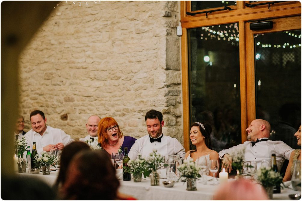 top table during speeches at a a kingscote barn wedding