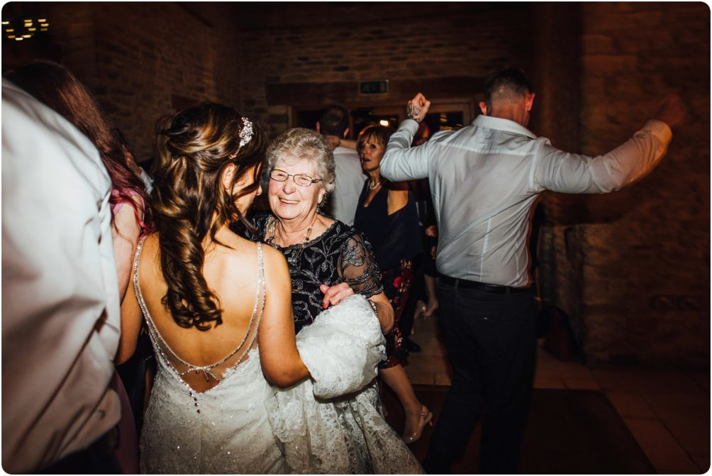 bride dancing with gran at a kingscote barn wedding