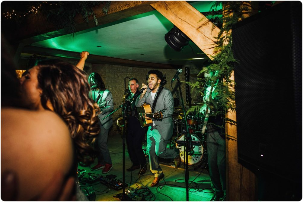 brother from another playing at a kingscote barn wedding
